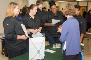 culinary arts students speak with an admissions rep from HVCC