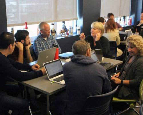 Teachers at table share ideas