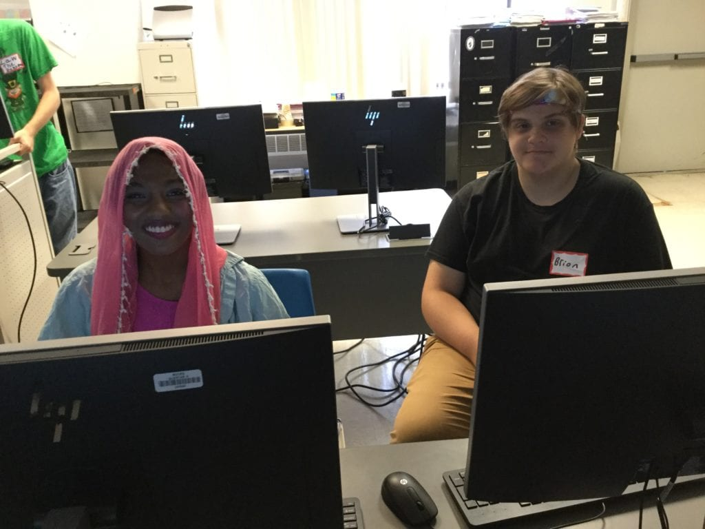 Students sitting in front of computer.