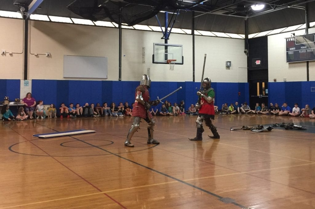 photo of knights jousting in a school gym