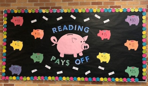 "photo of bulletin board reading ""reading pays off"""