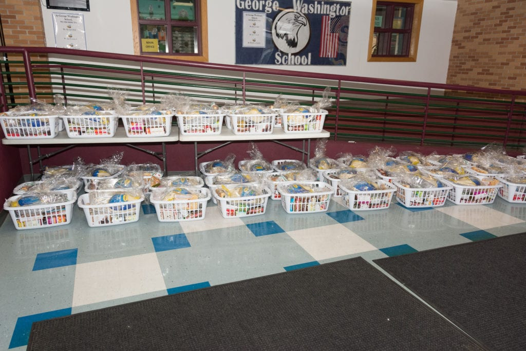 Photo of Thanksgiving meal baskets in the entryway of George Washington School