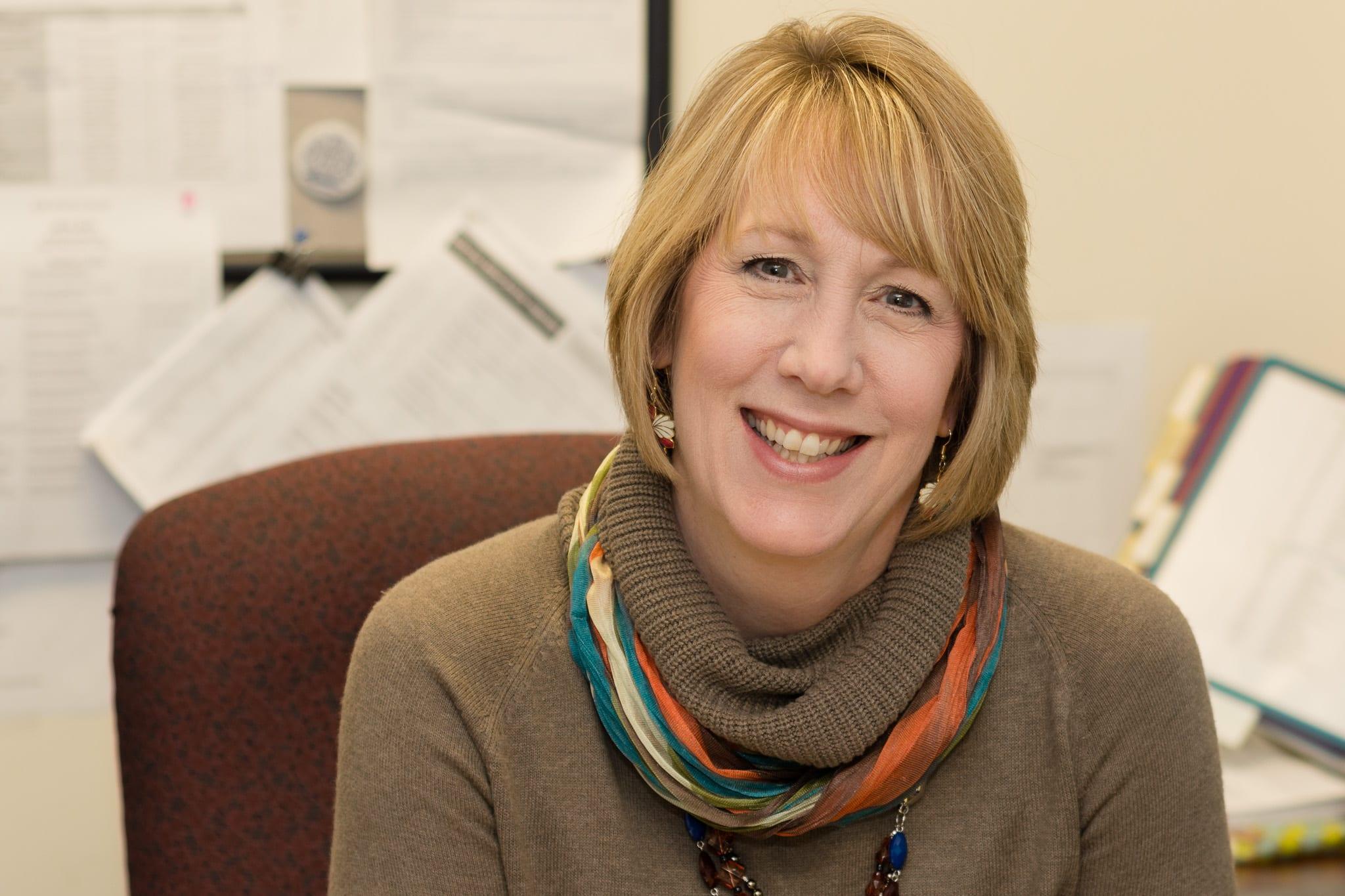 photo of Cyndi Herron in her office.