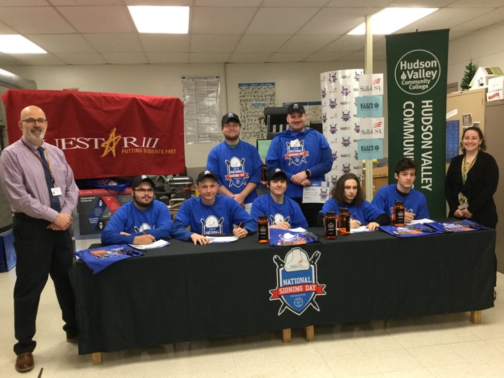 Image is of students and staff from Career Technical Education program preparing to sign letters of intent to go on to college after graduation.